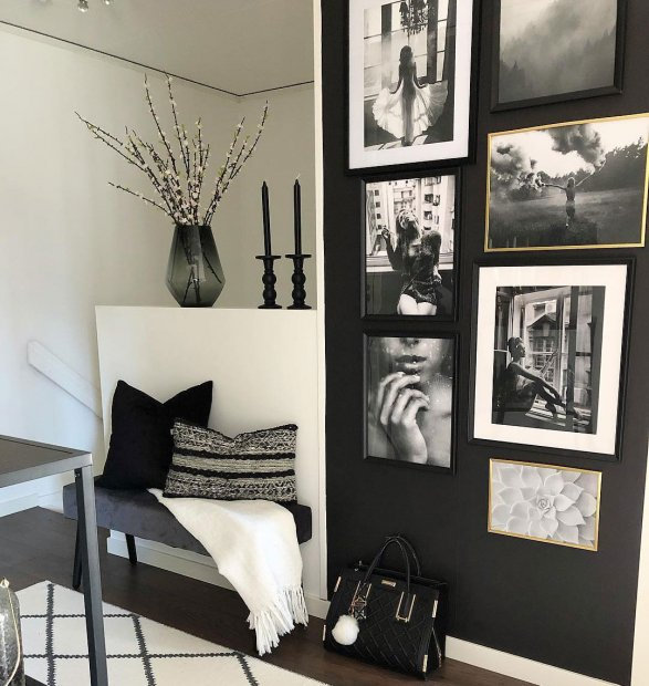 Gallery wall in French style in black wooden frames