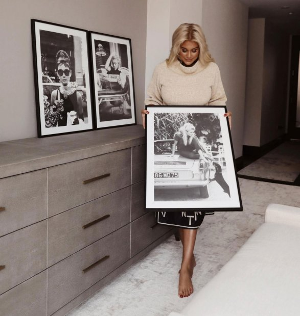 Iconic black and white prints in black wooden frames