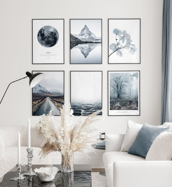 Winterly gallery wall with nature posters in chilly blue colors in black metal frames