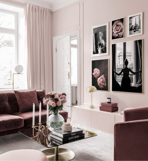Pink gallery wall with flowers and black and white posters