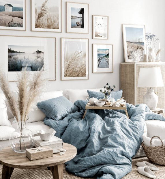 Soothing gallery wall beige blue living room nature posters oak frames
